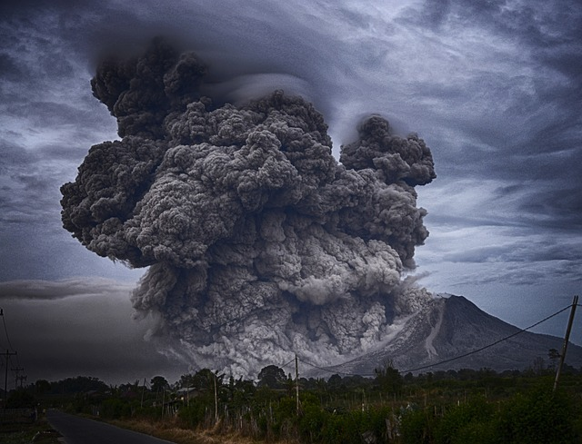 Volcanic ash spread; caused by eruption