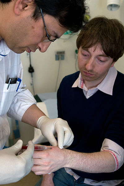 RFID microchip implant by a surgeon